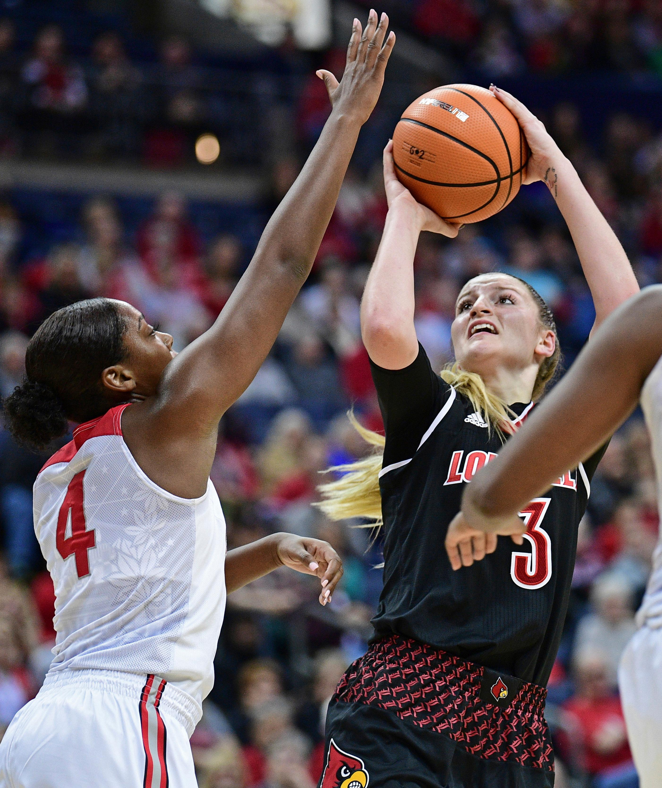 Louisville's Sam Fuehring shoots over Ohio State's Sierra Calhoun during the first quarter of an NCAA college basketball game, Sunday, Nov. 12, 2017, in Columbus, Ohio. (AP Photo/David Dermer)