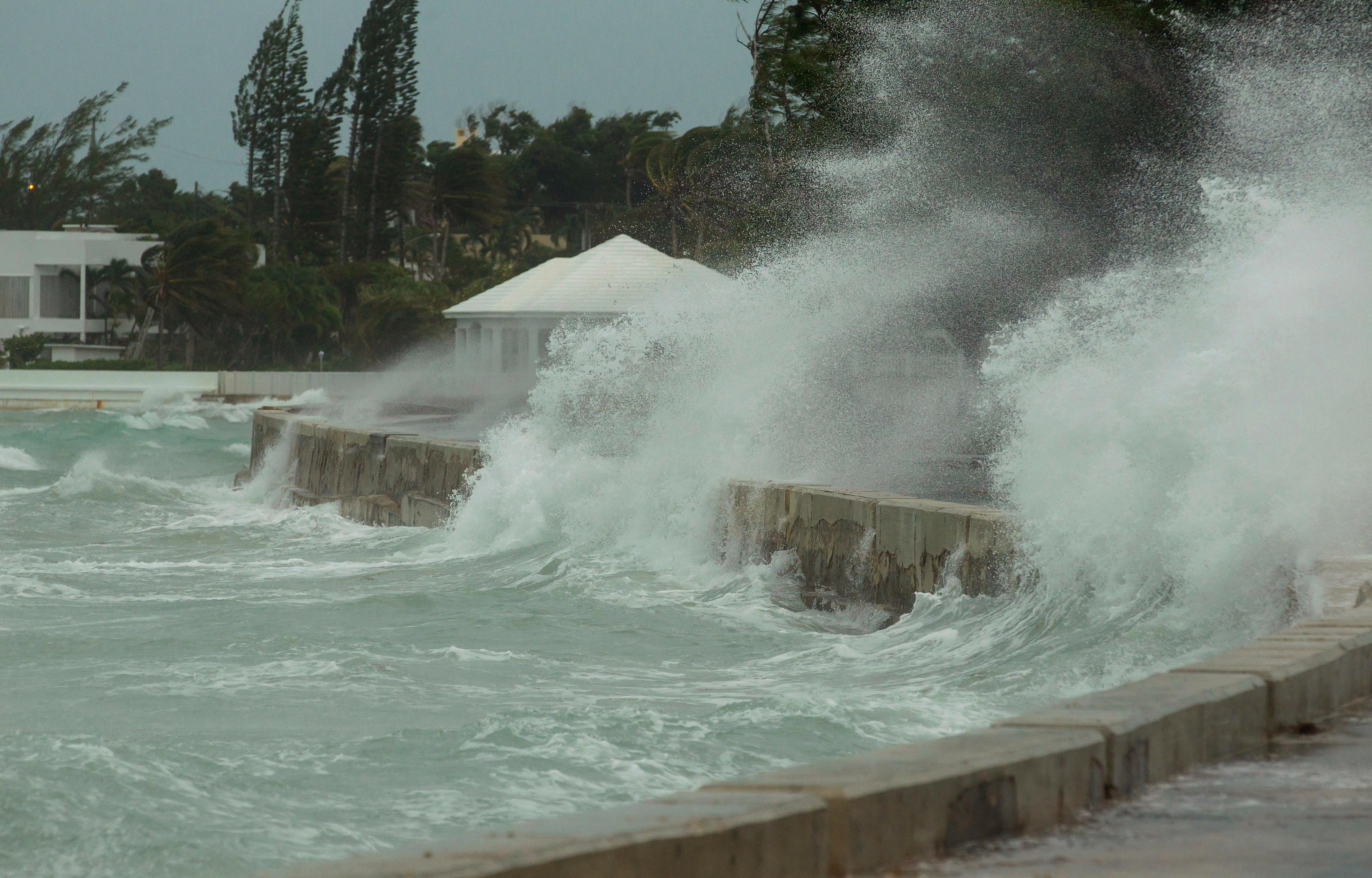 Rough seas flood a seawall on the eastern end of Nassau, Bahamas, Saturday, Sept 9, 2017, as Hurricane Irma moves along the coast of Cuba. (AP Photo/Tim Aylen)