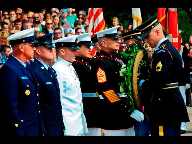 Marine Corps Sgt. Maj. Bryan B. Battaglia, fifth from left, senior enlisted advisor to the chairman of the Joint Chiefs of Staff, receives assistance from a soldier assigned to the 3rd U.S. Infantry Regiment during a wreath-laying ceremony.