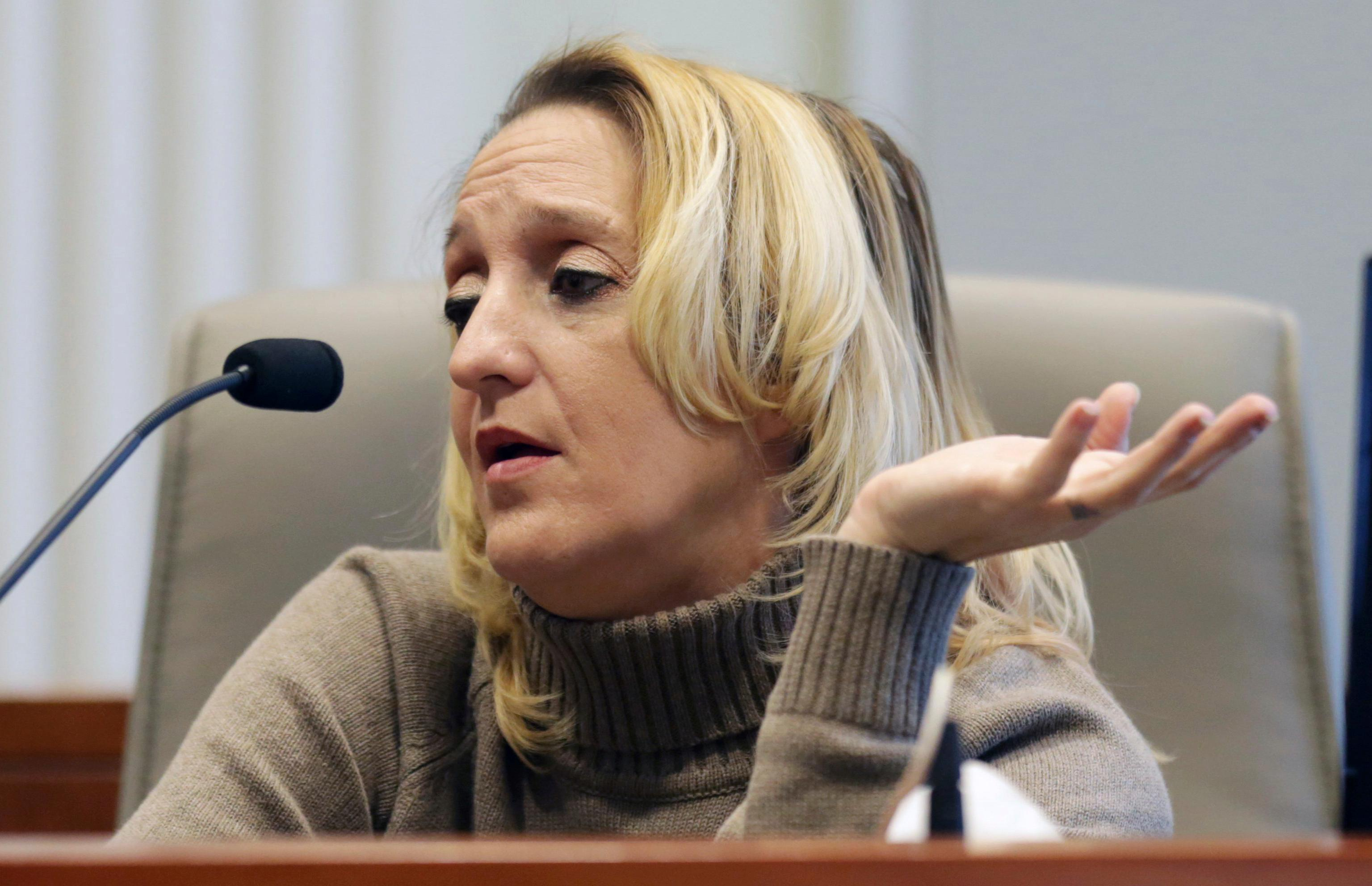 Lisa Britt answers a question by executive director of the Board of Elections Kim Strach during the public evidentiary hearing on the 9th Congressional District investigation Monday, Feb. 18, 2019, at the North Carolina State Bar in Raleigh, N.C. (Juli Leonard/The News & Observer via AP, Pool)