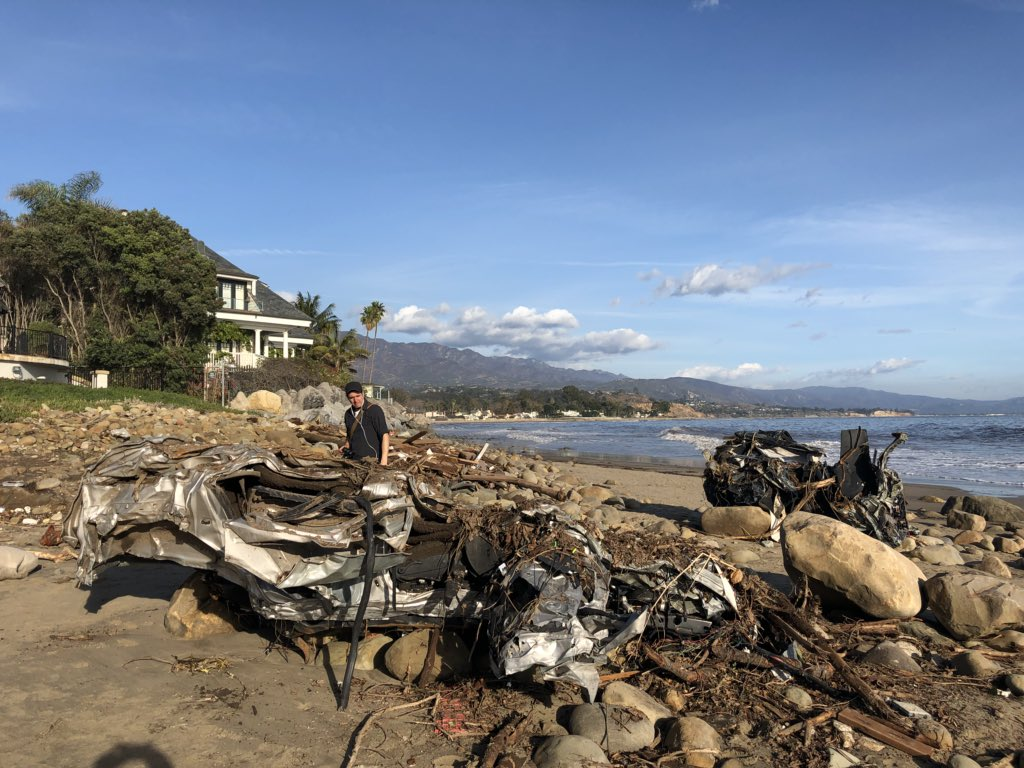 A Hummer H3 and unknown model Honda sit on the beach mangled feet just from the Pacific Ocean after being carried down Montecito Creek following heavy rain early Tuesday. (Photo & Caption: Mike Eliason, Santa Barbara County Fire Dept.)