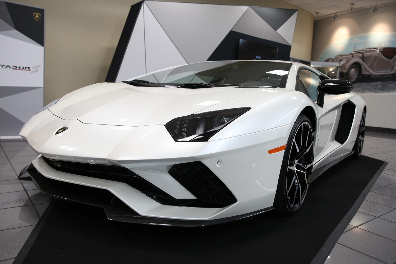 VIP car enthusiasts gathered at Lamborghini Sterling to catch a glimpse of the new Aventador S on Feb. 10. The exclusive event allowed guests to take a look back at Lamborghini's history before gazing into the company's future with its stunning new ride. (Amanda Andrade-Rhoades/DC Refined)