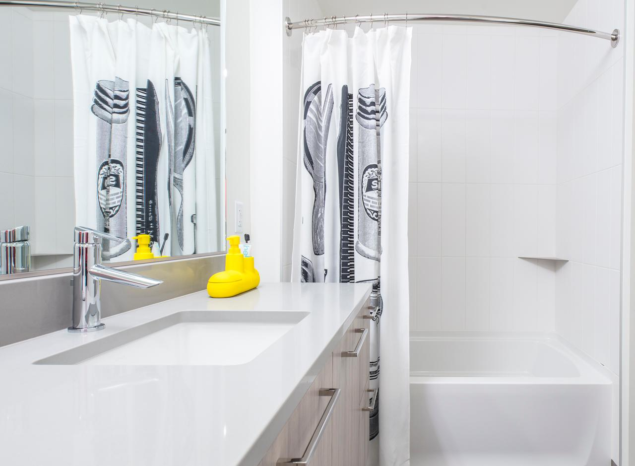 The bathroom in a two bedroom apartment at AMLI Arc