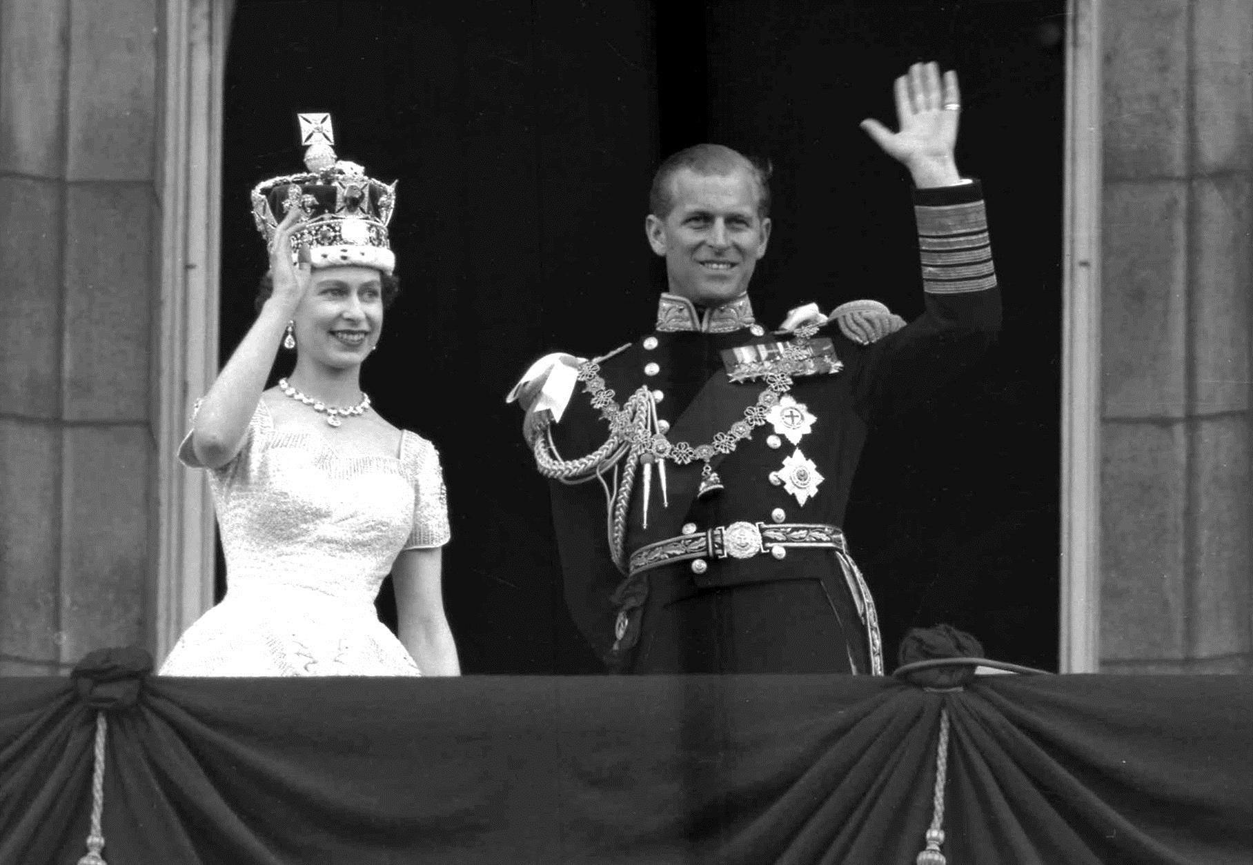 FILE - This is a June. 2, 1953 file photo of Britain's Queen Elizabeth II and Prince Philip, Duke of Edinburgh, as they wave to supporters from the balcony at Buckingham Palace, following her coronation at Westminster Abbey. London. At the age of 96, Britain's Prince Philip on Wednesday Aug. 2, 2017 retires from solo official duties. Over the decades he has become renowned for his stalwart support of his wife, Queen Elizabeth II. (AP Photo/Leslie Priest, File)