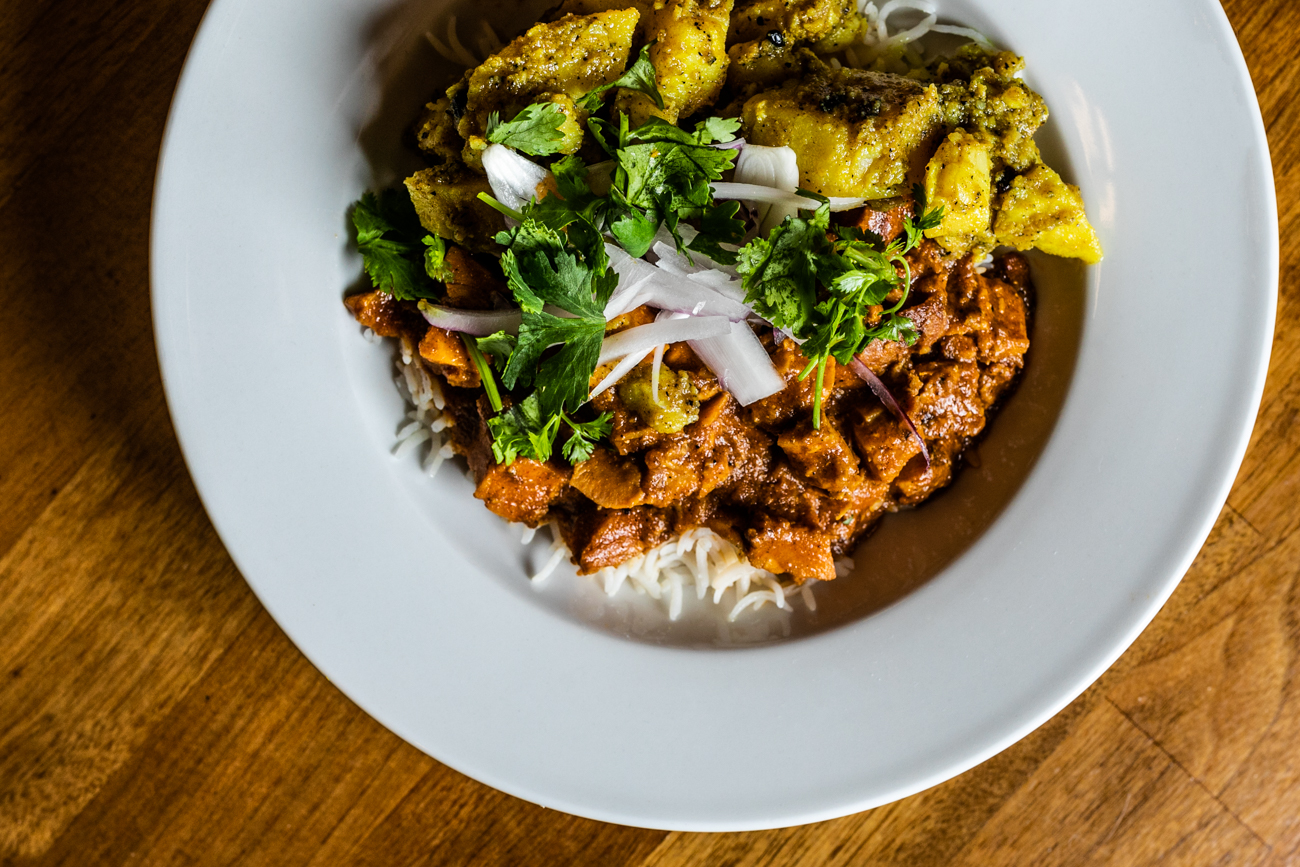 Hakku Chuala Rice Bowl: grilled chicken marinated with Nepali spices, ginger, and olive oil served with basmati rice and yellow peas / Image: Amy Elisabeth Spasoff // Published: 8.22.19