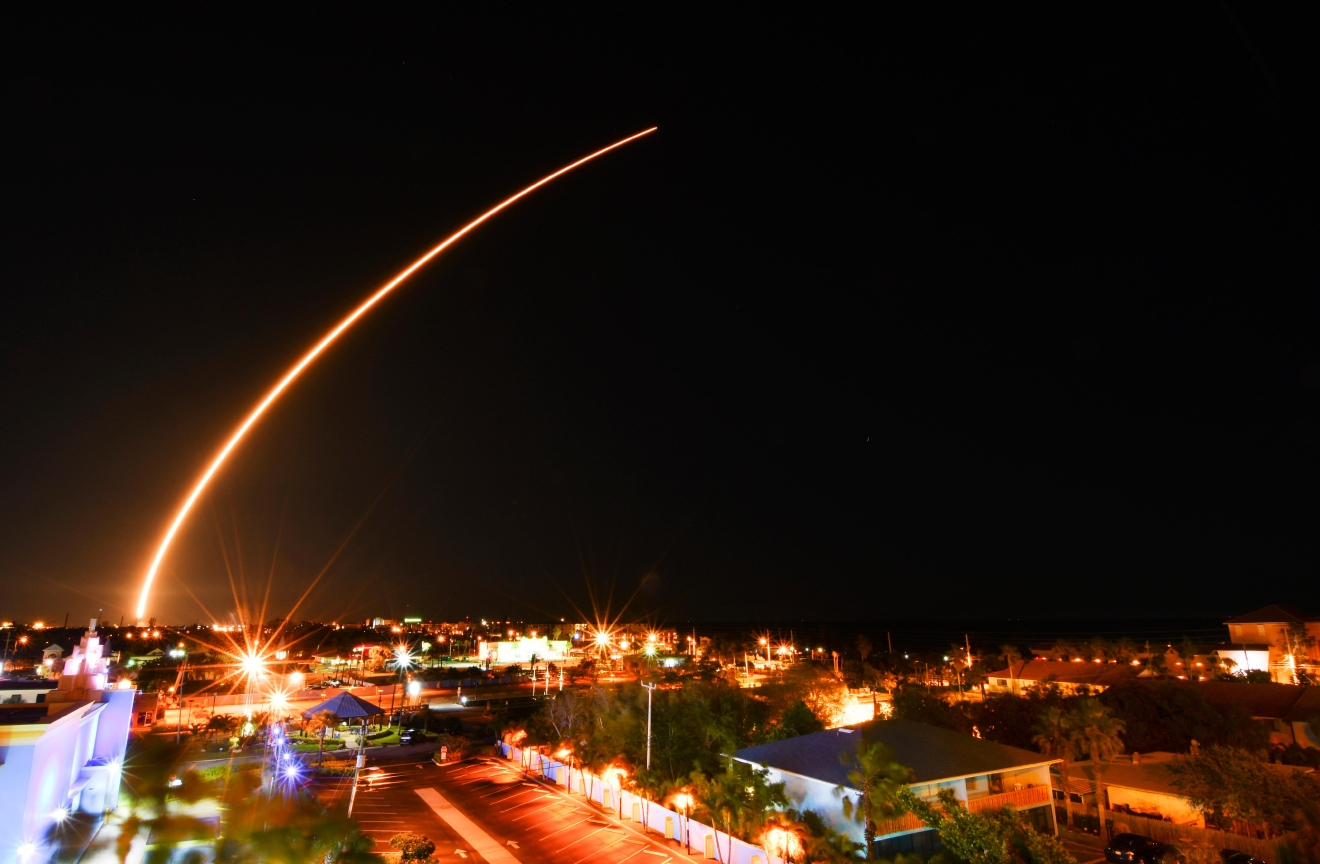 A SpaceX Falcon 9 rocket launches from Kennedy Space Center, over Cocoa Beach and Cape Canaveral skyline in Florida on Thursday, March 16, 2017. The rocket, carrying the Echostar XXIII communications satellite was delayed from Tuesday due to high winds. (Malcolm Denemark/Florida Today via AP)