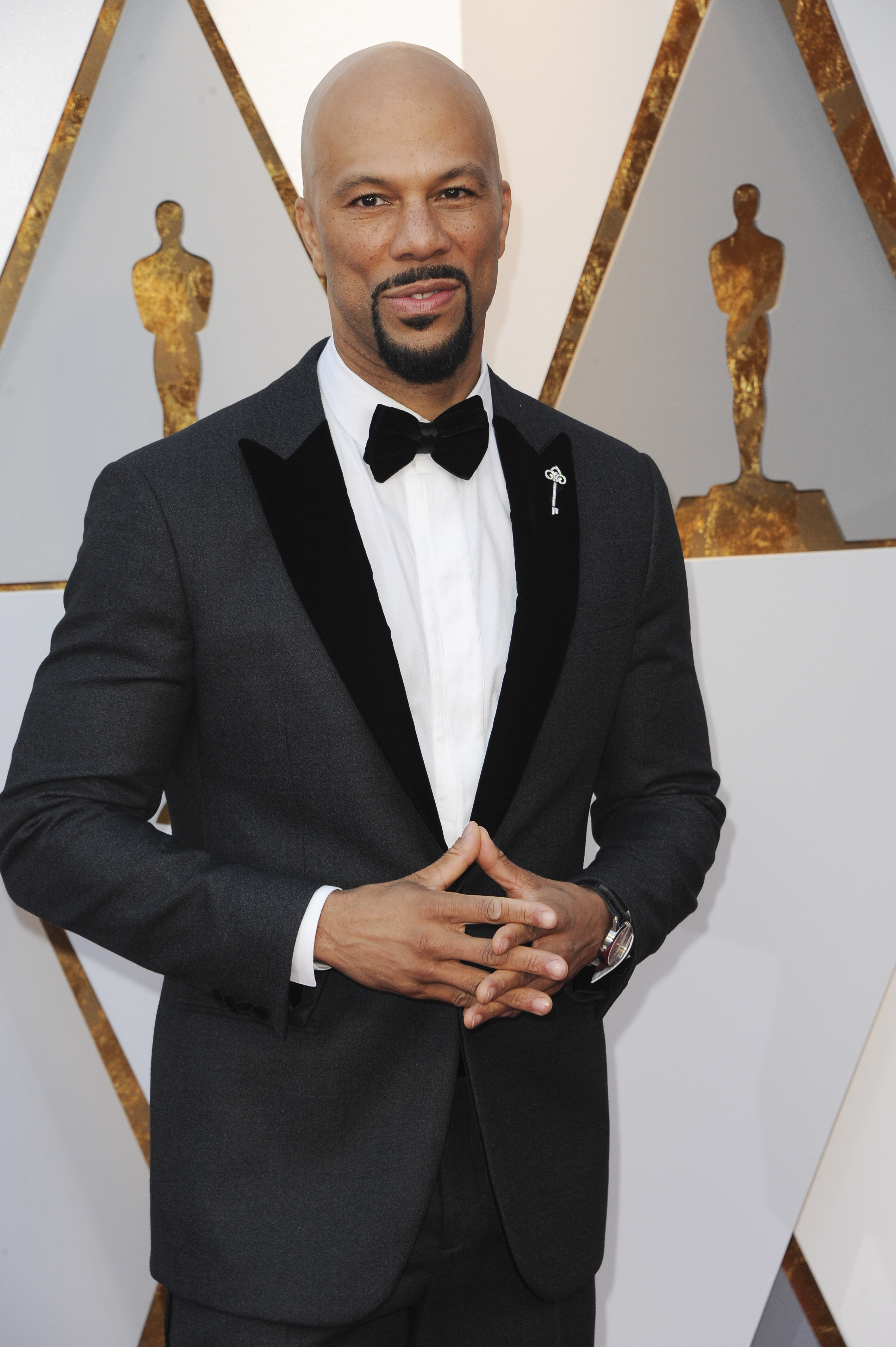 I had tears in my eyes as Common performed &quot;Stand Up For Something&quot; alongside Andra Day (and local boy Jose Andres made an appearance!) and the rapper didn't look too bad doing it in Armani with a Tiffany &amp;amp; Co. watch and pin. (Image: Apega/WENN.com)<p></p>