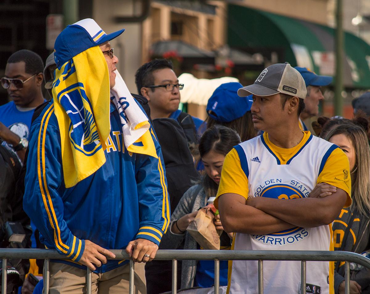 Decked out in blue and gold, fans wait for the Golden State Warriors victory parade to commence. Photo by Emily Gonzalez, Oregon News Lab.
