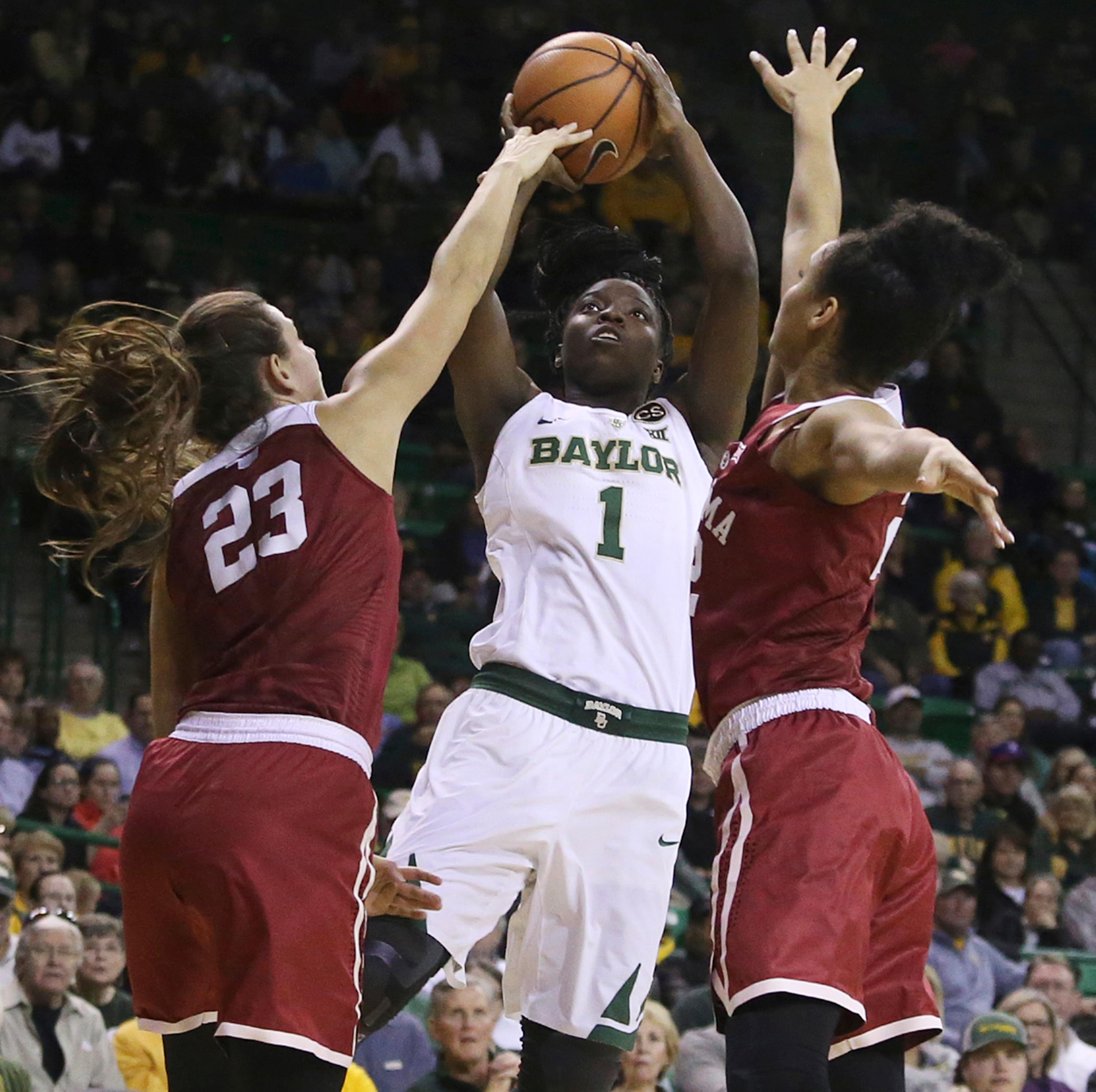 Baylor forward Dekeiya Cohen, center, shoots between Oklahoma guard Maddie Manning, left, and Oklahoma guard Ana Llanusa, right, during the first half of an NCAA college basketball game, Monday, Feb. 5, 2018, in Waco, Texas. (AP Photo/Jerry Larson)