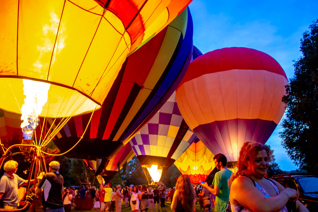 Over a dozen hot air balloons illuminated the sky as the sun set. They were organized by balloon meister Brian Trapp, who has coordinated the display every year. Visitors were able to walk around and see them up-close. / Image: Katie Robinson, Cincinnati Refined // Published: 8.29.19