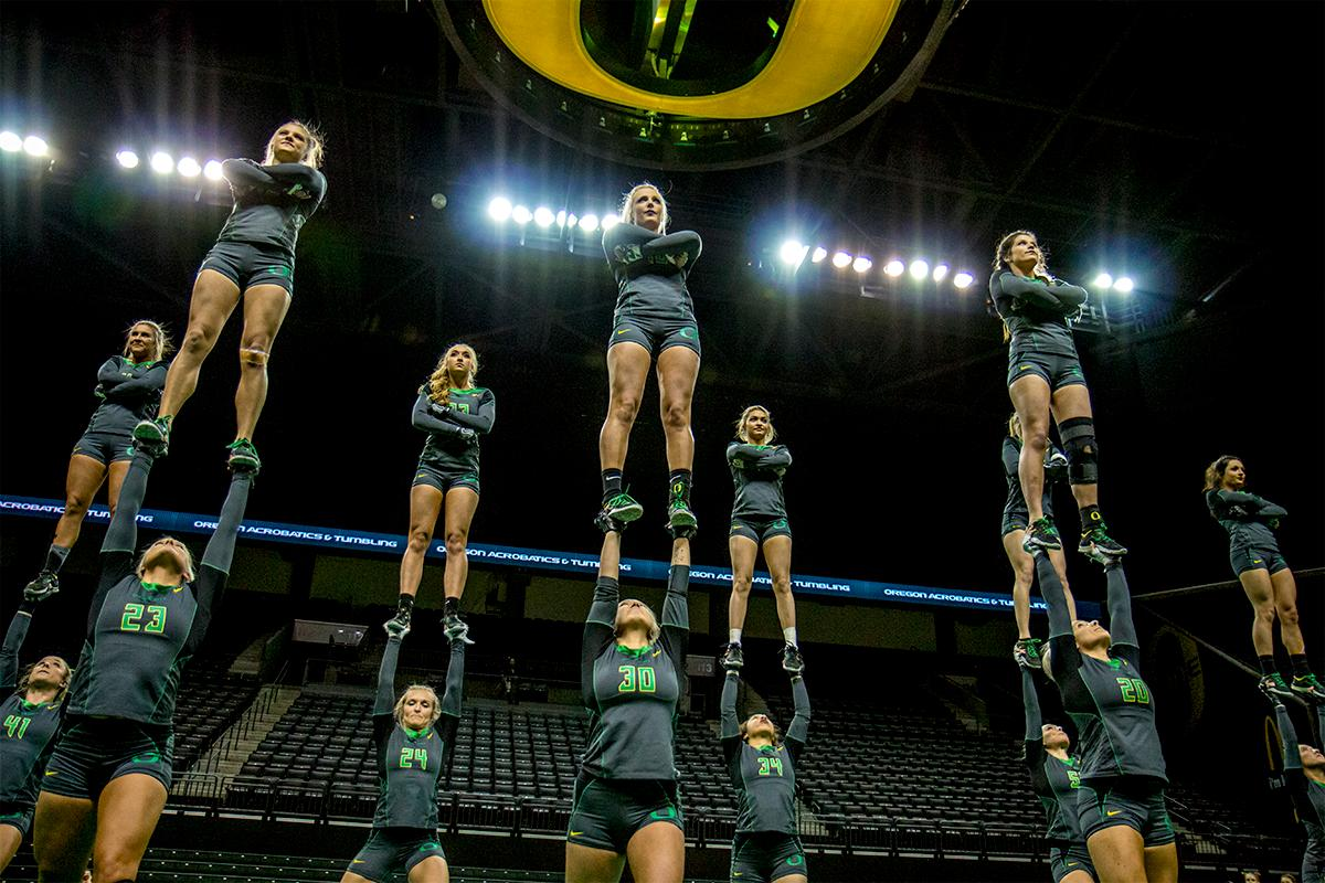 At their last home meet of the year and on Senior Night, the Ducks Acro and Tumbling Team defeated the Azusa Pacific Cougars, winning in all six categories: 38.70 to 37.20 in Compulsory; 29.35 to 28.60 in Acro; 29.40 to 29.35 in Pyramid; 29.35 to 28.95 in Toss; 57.525 to 66.15 in Tumbling; 103.75 to 98.03 in Team Routine; for an overall total of 288.08 to 277.28. The Ducks finished the season 6-1 and will next compete in the NCATA National Championship at Azusa, California April 27-29. Photo by August Frank, Oregon News Lab
