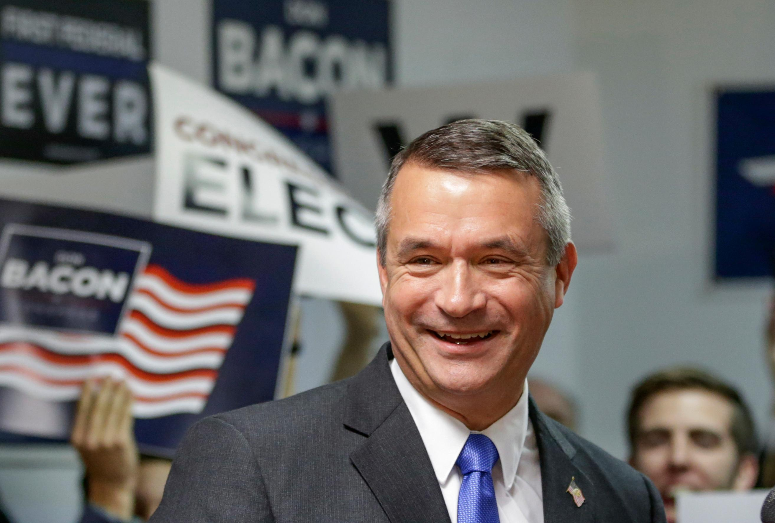 FILE - In this Nov. 9, 2016, file photo, Rep. Don Bacon, R-Neb., smiles during a news conference in Omaha, Neb., after winning the race for Nebraska's 2nd Congressional District. The Omaha-based 2nd Congressional District has changed party hands twice in the past two elections, and Democrats Brad Ashford and Kara Eastman are optimistic they can defeat first-term U.S. Rep. Don Bacon. Democratic and independent voters will pick Ashford or Eastman as the party's nominee in the primary election on Tuesday, May 15, 2018. (AP Photo/Nati Harnik)