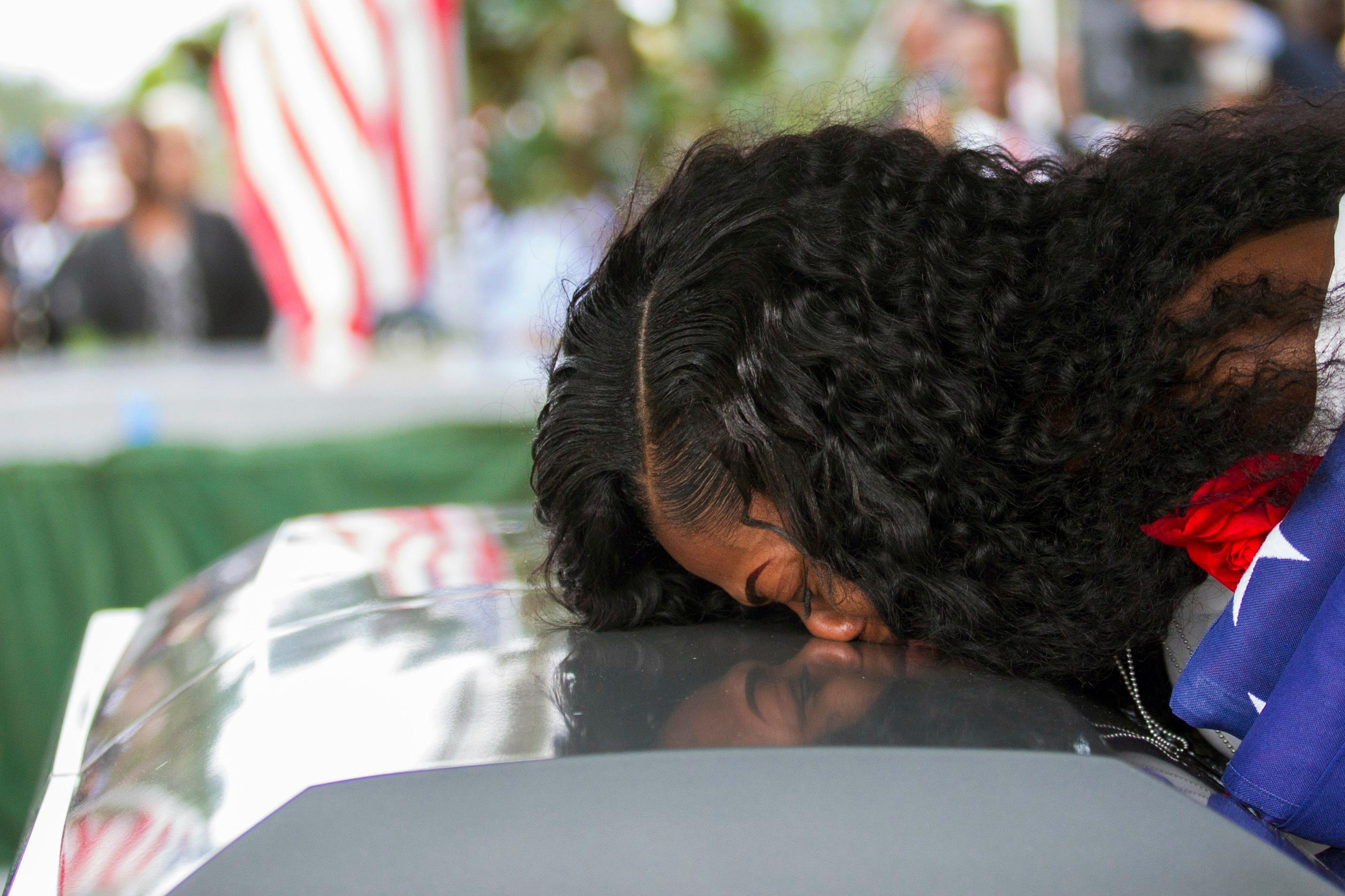 "FILE - In this Saturday, Oct. 21, 2017, file photo, Myeshia Johnson kisses the casket of her husband, Sgt. La David Johnson during his burial service at Fred Hunter's Hollywood Memorial Gardens in Hollywood, Fla. Myeshia Johnson told ABC's ""Good Morning America"" on Monday, Oct. 23, 2017, that she has nothing to say to the president, adding that his phone call to her made ""me cry even worse."" (Matias J. Ocner/Miami Herald via AP, File)"