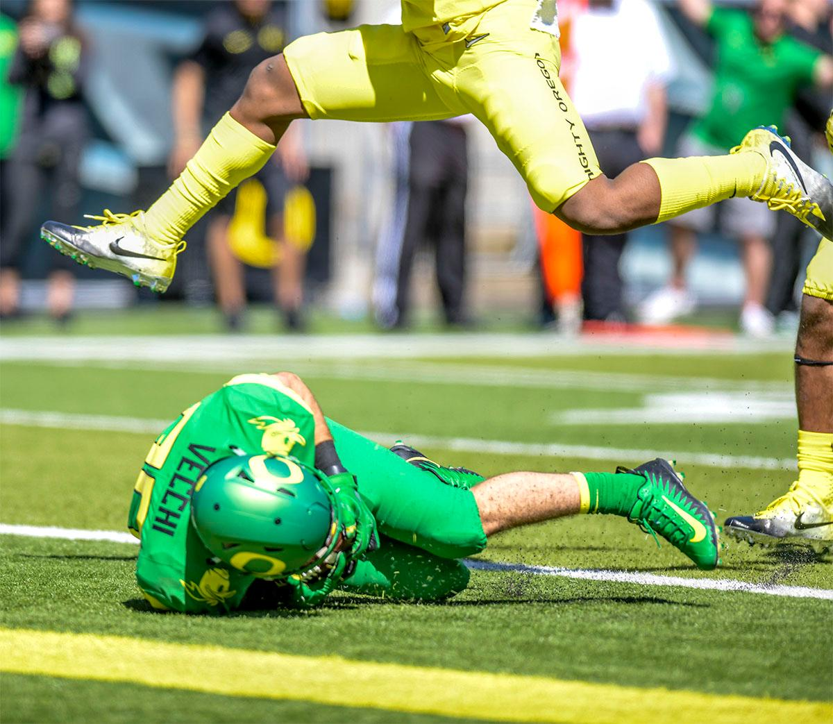 The Thunder's Jack Vecchi (#90) comes skidding to a stop in the end zone for a touchdown. The Thunder defeated the Lightning 59-24 in the Spring Game on Saturday at Autzen Stadium. Photo by August Frank