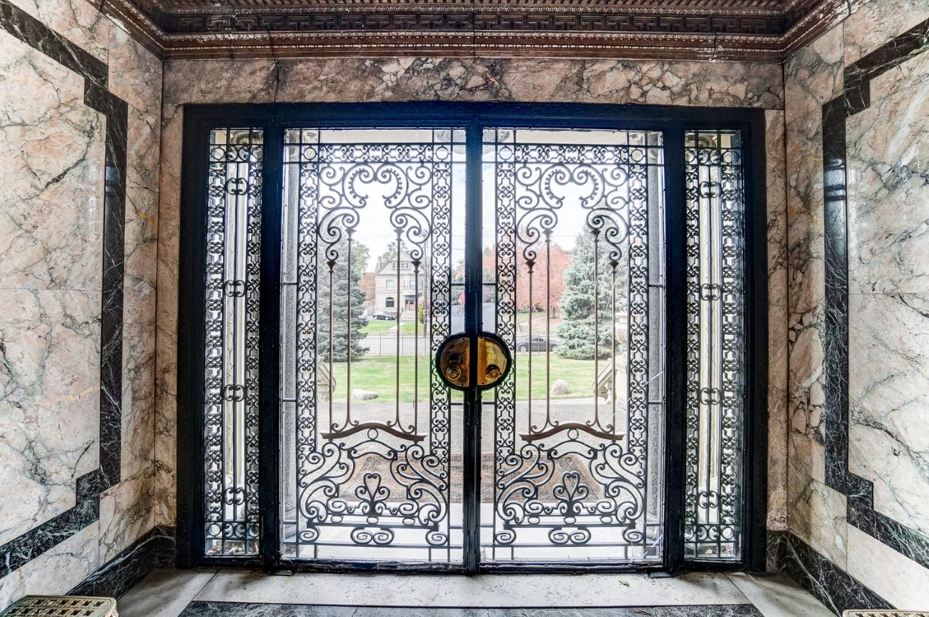 These ornate doors open onto the marble foyer of the Herschede Mansion. / Image: Adam Sanregret courtesy of Coldwell Banker West Shell // Published: 4.3.20