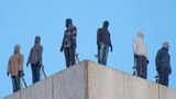 PHOTOS | Harrowing sculptures atop London building aim to raise awareness of male suicide