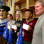 Thomas More College's president hand delivers acceptance letters to students