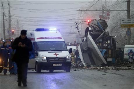 An ambulance leaves the site of a trolleybus explosion in Volgograd, Russia, Monday, Dec. 30, 2013. The explosion left 10 people dead Monday, a day after a suicide bombing that killed at least 17 at the city's main railway.