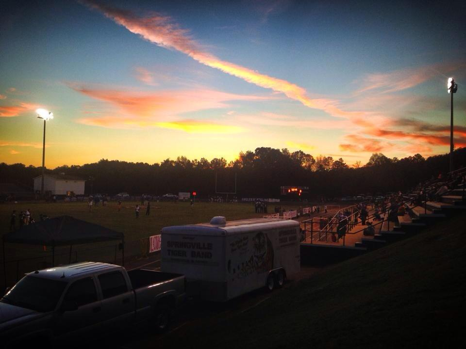 Sunset before kickoff between Mortimer-Jordan at Sprinville, Friday, Oct. 24, 2014.