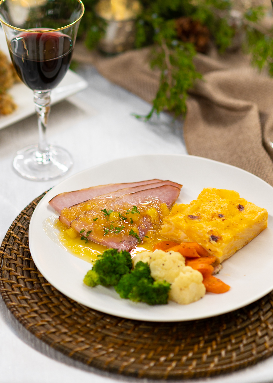 The Holiday Dinner Buffet. Pictured: hickory smoked ham with pineapple glaze, au gratin potatoes, broccoli, cauliflower, and carrots. / Image: Phil Armstrong, Cincinnati Refined // Published: 11.6.20