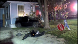 Woman crashes car into house, runs off on foot