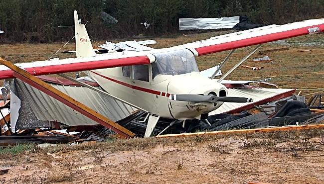 A damaged plane from the Addison Municipal Airport in Winston County surrounded by debris of storm damage.