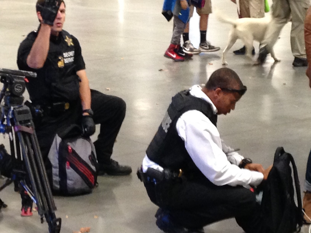 Police carefully checking media bags at the DonaldTrump rally in Asheville. (Photo credit: WLOS staff)