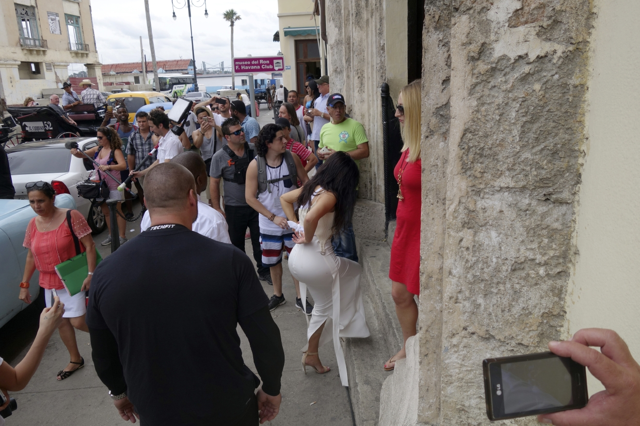 American reality-show star Kim Kardashian West, center in white, enters the Havana Club Rum Museum in Havana, Cuba, Wednesday, May 4, 2016. Rap superstar Kayne West, his wife Kim Kardashian and members of her reality-show-star family have become the latest celebrities to visit Havana. They visited HavanaÂ?s Museum of Rum Wednesday, stepping out of a hot-pink antique American convertible as they snapped selfies and were recorded by a television crew following them around.(AP Photo/Desmond Boylan)