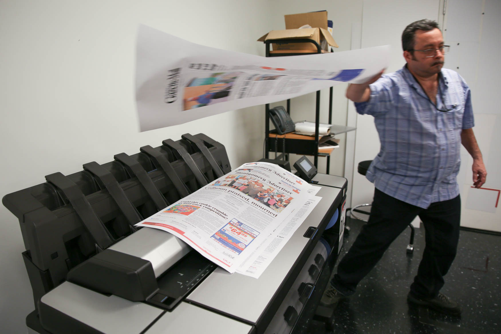 The papers are printed on one of three industrial scale printers.{ }(Amanda Andrade-Rhoades/DC Refined)