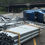 Semi driver hits curve at 55 mph, dumps load of pipes under I-5 in Tukwila