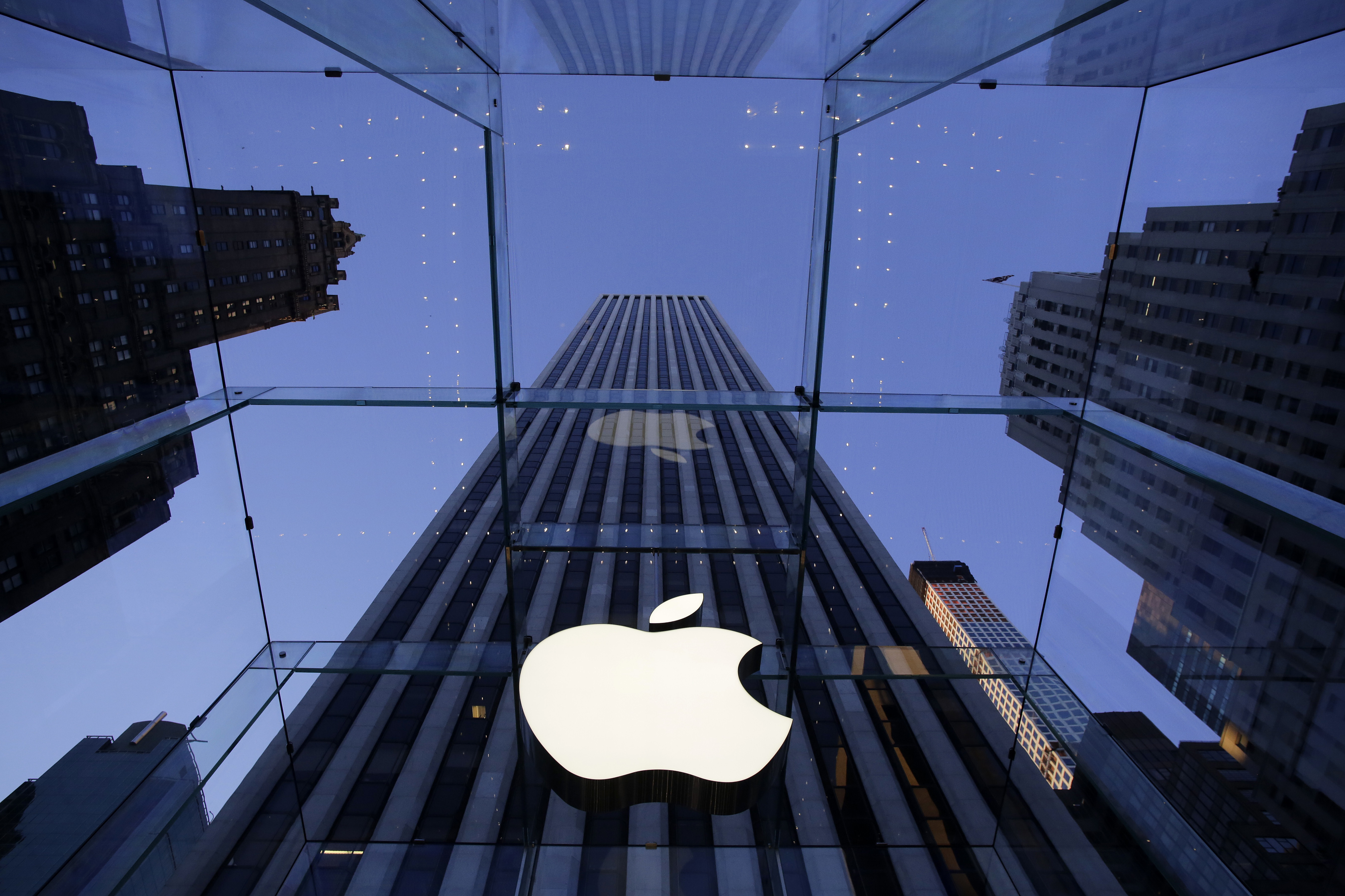 Apple sorry for slowing iPhones, cuts battery price by $50. (AP Photo/Mark Lennihan, File)