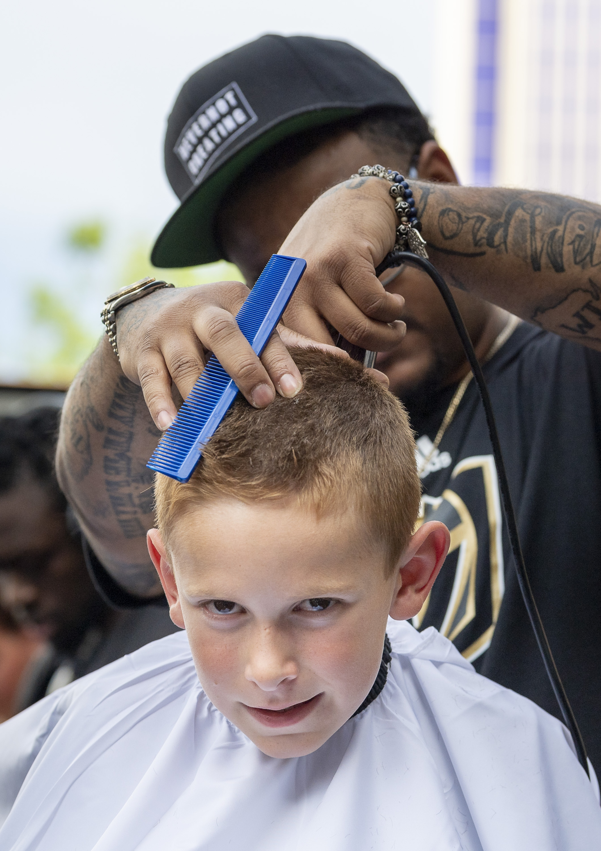 "Eight year-old Landon Lythgoe of Las Vegas has the trademark ""V"" shaved into his scalp as part of the pre-game celebration in Toshiba Plaza as the Vegas Golden Knights prepare to meet the Los Angeles Kings in the first quarterfinal game of the NHL Stanley Cup Playoffs at T-Mobile Arena in Las Vegas on Wednesday, April 11, 2018.  CREDIT: Mark Damon/Las Vegas News Bureau"