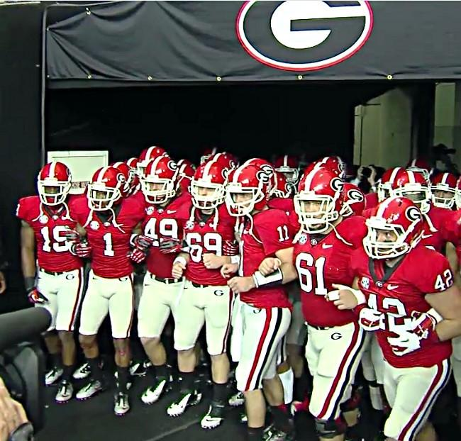 Georgia prepares to run on the field at the 2012 SEC Championship in Atlanta on Saturday, December 1, 2012.
