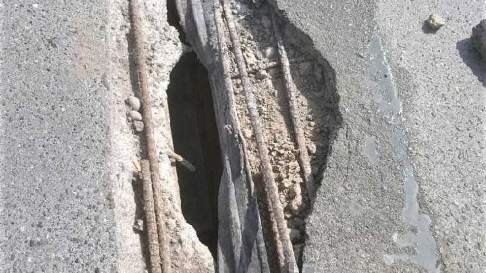 File photo of exposed rebar and a hole in the surface of the I-5 Ship Canal Bridge in Seattle. (photo: KOMO News).{ }