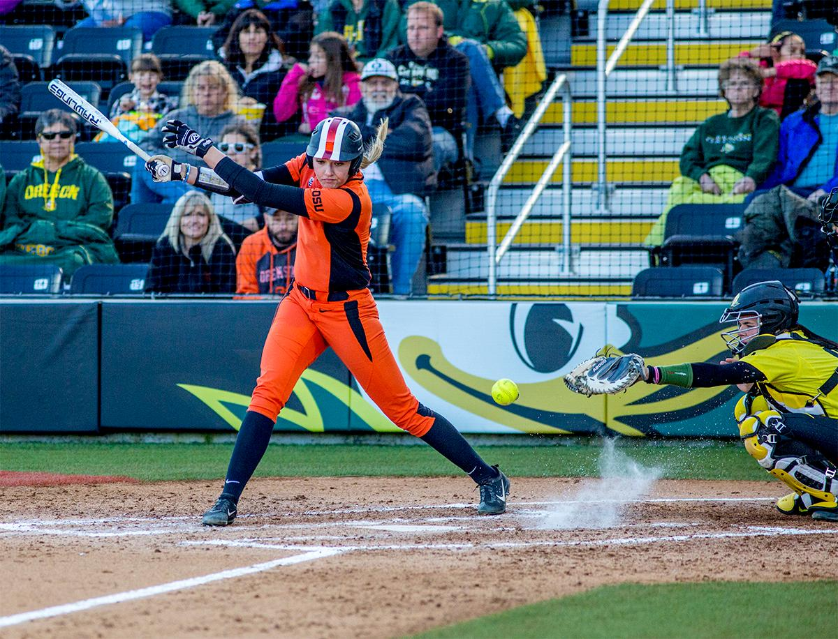 The  Beavers Natalie Hampton (#15) misses the ball as it bounces up from the ground. The Oregon Ducks defeated the Oregon State Beavers 8-0 in game one of the three-game Civil War series on Friday night at Jane Sanders Stadium. The game was 0-0 until Gwen Svekis (#21) hit a solo home run in the fourth inning. Mia Camuso hit a grand slam in the fifth inning, ending the game for the Ducks by mercy rule. With tonight's victory, the Ducks are 39-6 and 12-6 in Pac-12 play. Photo by August Frank, Oregon News Lab
