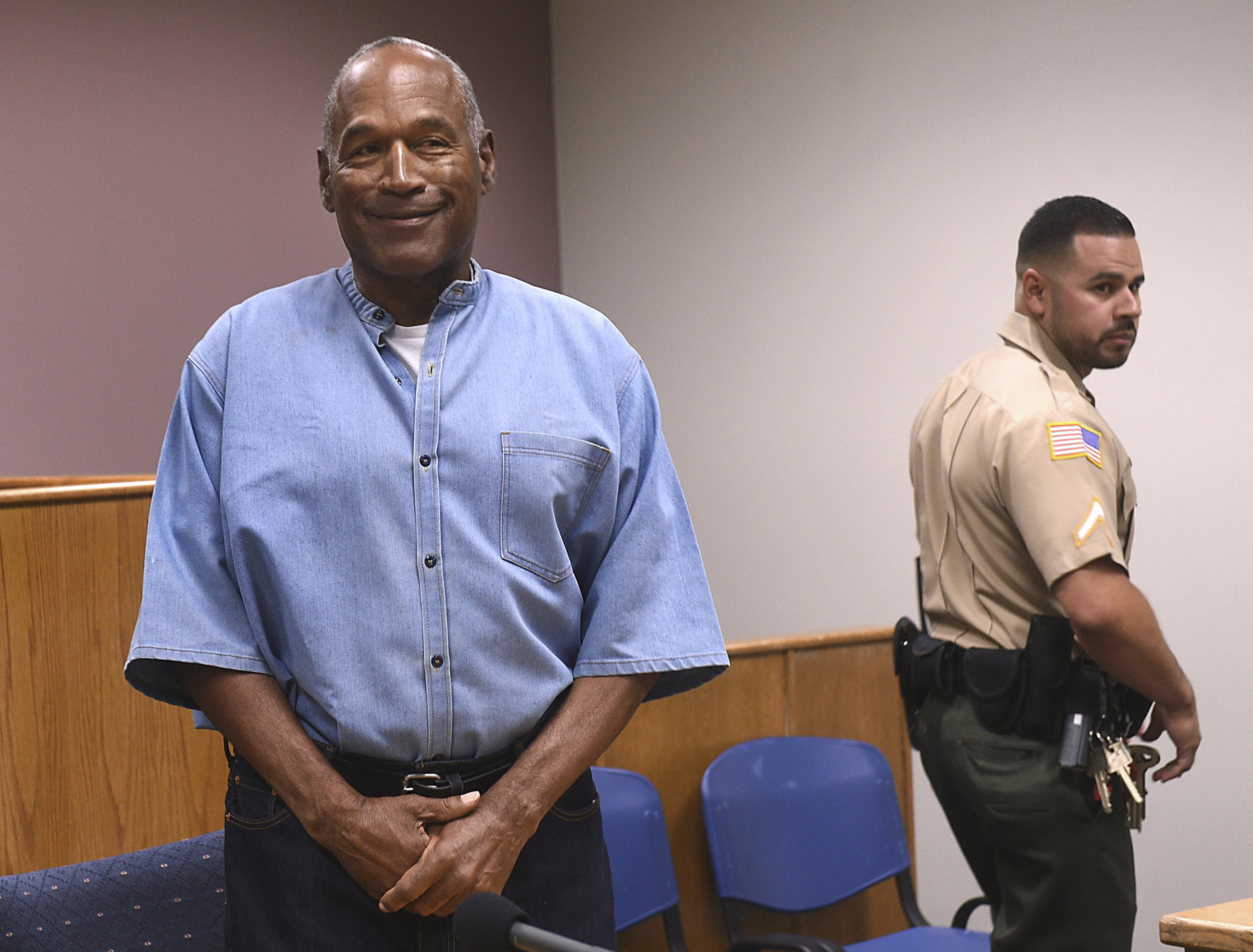 FILE - In this July 20, 2017, file photo, former NFL football star O.J. Simpson enters for his parole hearing at the Lovelock Correctional Center in Lovelock, Nev. A Nevada prison official said early Sunday, Oct. 1, 2017, O.J. Simpson, the former football legend and Hollywood star, has been released from a Nevada prison in Lovelock after serving nine years for armed robbery.  (Jason Bean/The Reno Gazette-Journal via AP, Pool, File)