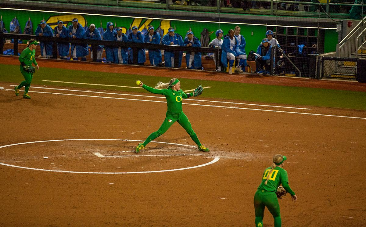 Pitcher Miranda Elish (#40) tosses a pitch in Game 2 against UCLA. The University of Oregon Ducks softball pitcher Miranda Elish held the UCLA Bruins scoreless for five innings as the Ducks put seven runs on the board. The Bruins rallied with a two-run homer in the sixth and a three-run home run in the seventh, but the Ducks held on and beat undefeated UCLA 7-5 at Jane Sanders Stadium Saturday. The Ducks improved their record to 24-5. Photo by William Tierney, Oregon News Lab