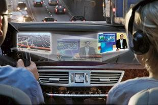 The Mercedes-Benz Splitview system allows the passenger & driver to see different screens. But some state laws don't allow that technology.