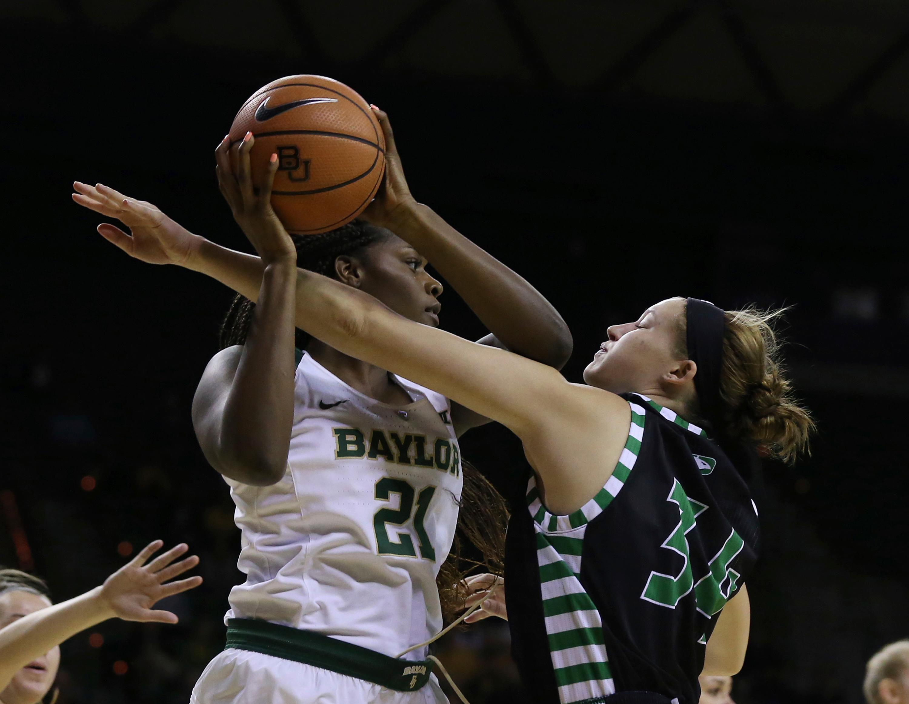North Dakota's Lexi Klabo, right, reaches for the ball held by Baylor center Kalani Brown during the second half of an NCAA college basketball game, Tuesday, Dec. 5, 2017, in Waco, Texas. (Rod Aydelotte/Waco Tribune Herald via AP)