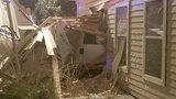 Truck crashes through one home, into another in East Austin