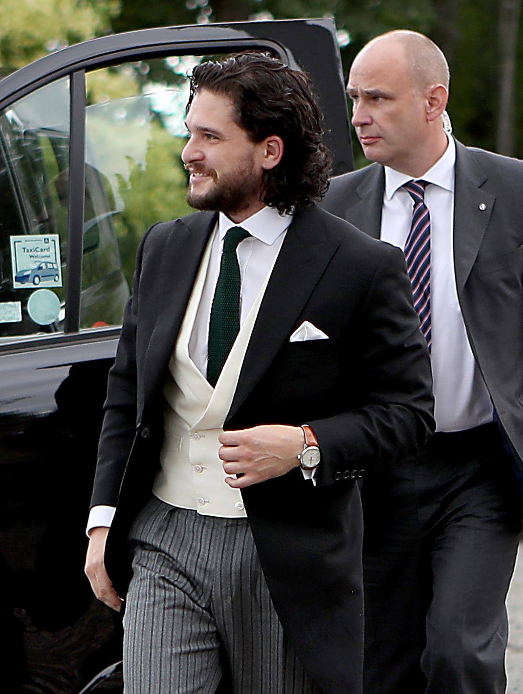 "Game of Thrones actor Kit Harington arrives, at Rayne Church, Kirkton of Rayne in Aberdeenshire, Scotland, Saturday June 23, 2018. Former ""Game of Thrones"" co-stars Kit Harington and Rose Leslie are marrying Saturday with a celebration at the bride's family castle in Scotland. The couple and guests arrived at Rayne Church, close to the 900-year-old Wardhill Castle in northeast Scotland, which is owned by Leslie's family. (Jane Barlow/PA via AP)"