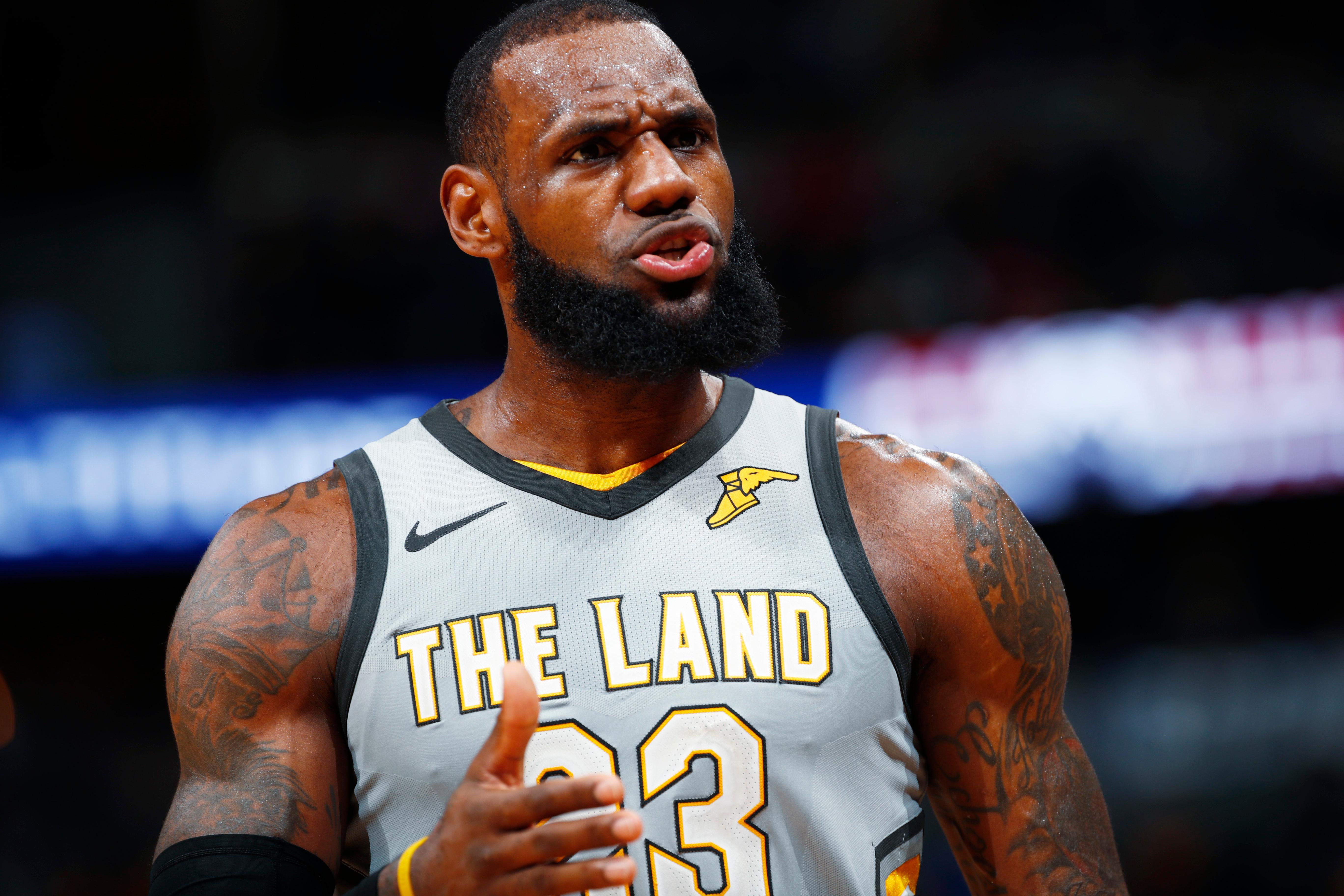 Cleveland Cavaliers forward LeBron James argues for a call against Denver Nuggets center Nikola Jokic late in the second half of an NBA basketball game Wednesday, March 7, 2018, in Denver. The Cavaliers won 113-108. (AP Photo/David Zalubowski)
