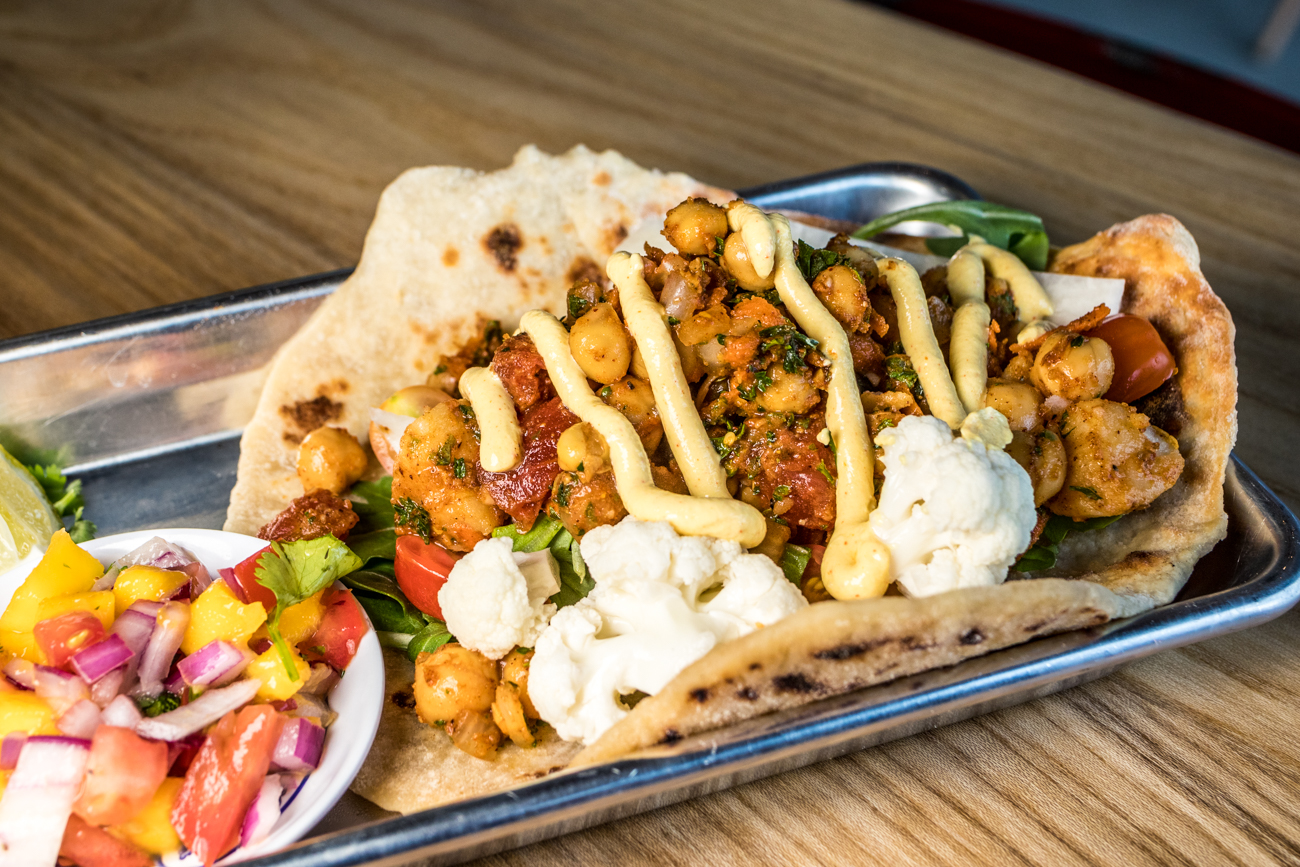 Village Veggie Roti: house-made flatbread, chickpeas, jicama, tomato, cauliflower, curried yogurt, and cilantro oil / Image: Catherine Viox // Published: 8.2.20