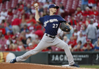 Milwaukee Brewers starting pitcher Zach Davies throws during the first inning against the Cincinnati Reds, Tuesday, Sept. 5, 2017, in Cincinnati.