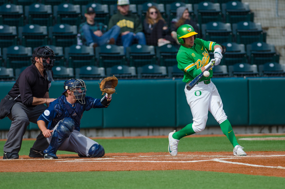 Mathew Dyer (7) moments before he nails a ground ball into right field. In the second of the three game series, the Ducks beat the UC Irvine Anteaters 6-3. Photo by Levi Gittleman, Oregon News Lab