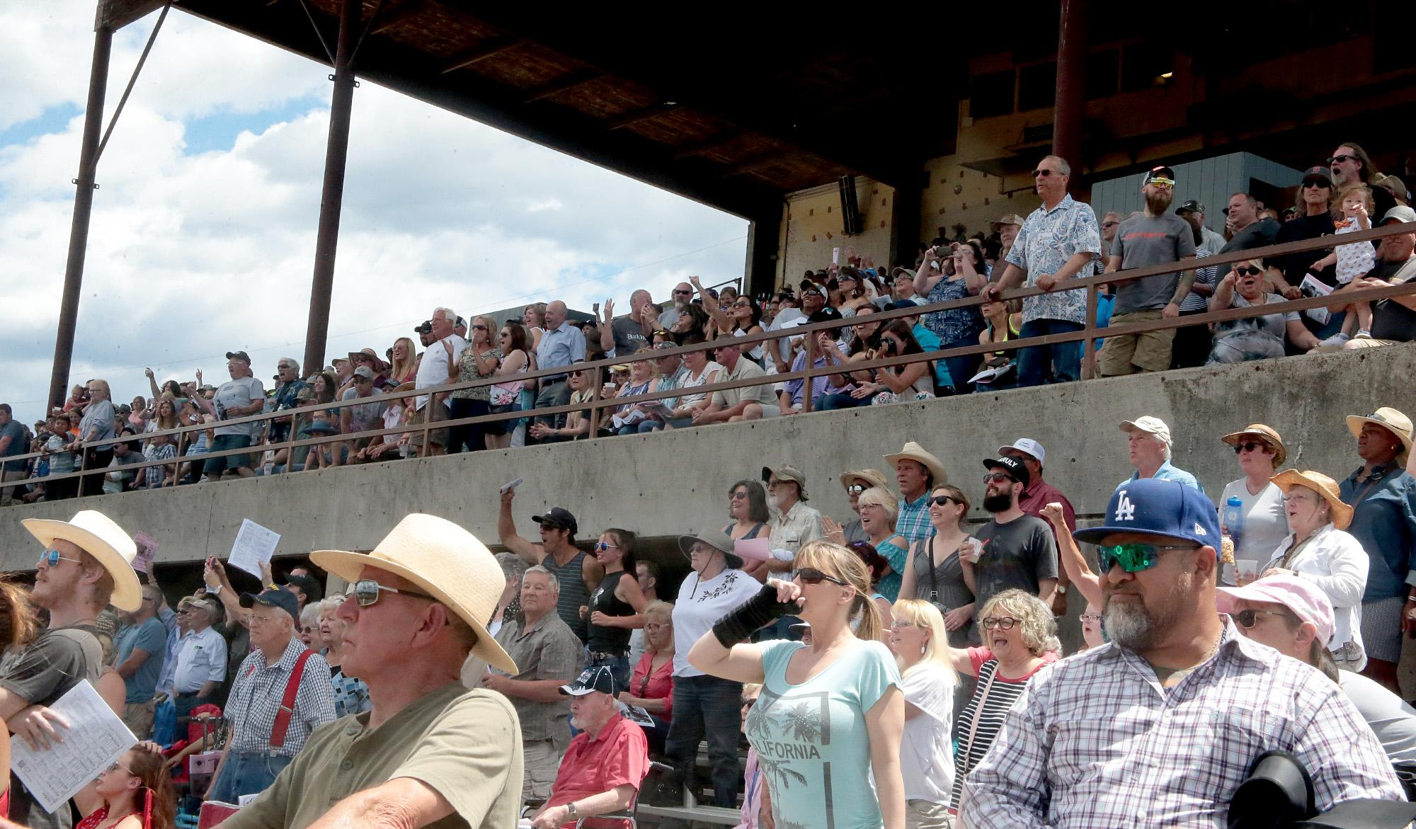 Spectators watching the Second Race at Grants Pass Downs on Sunday. [PHOTO BY:  LARRY STAUTH JR]