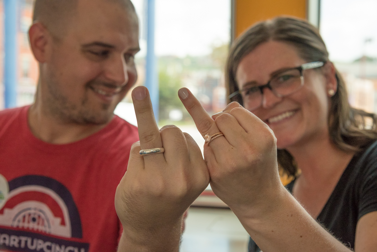 Newlyweds Brandon & Linsey Kraeling showing off their wedding rings on their first ride on the CB Connector / Image: Phil Armstrong, Cincinnati Refined