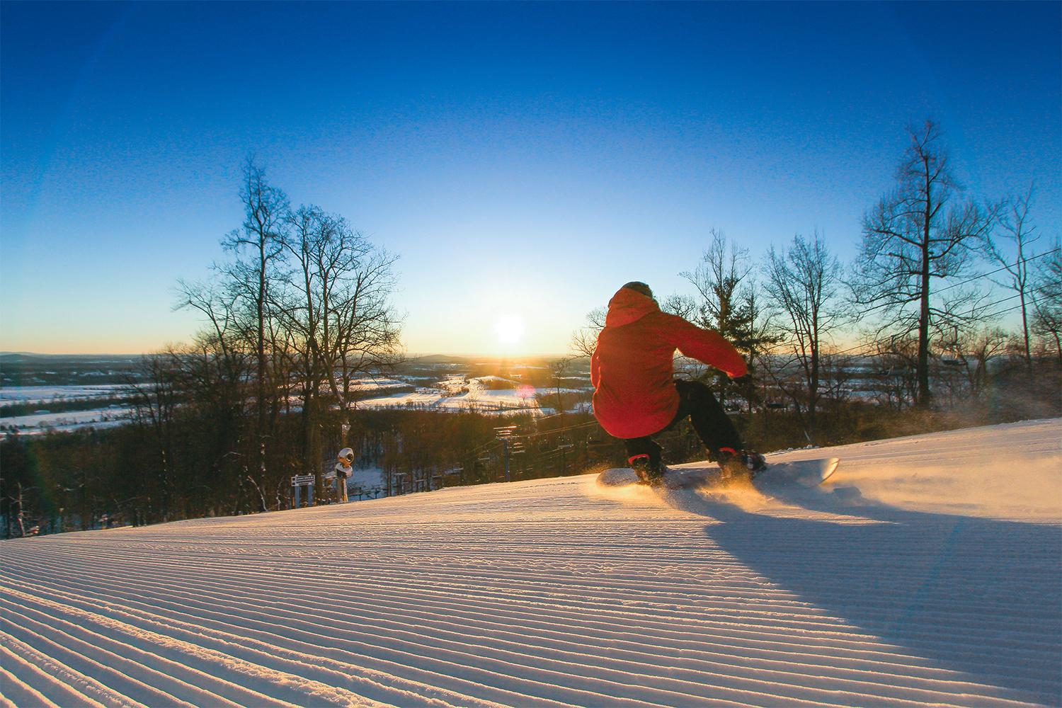 Snowboarder at sunset.{&amp;nbsp;}<p></p>