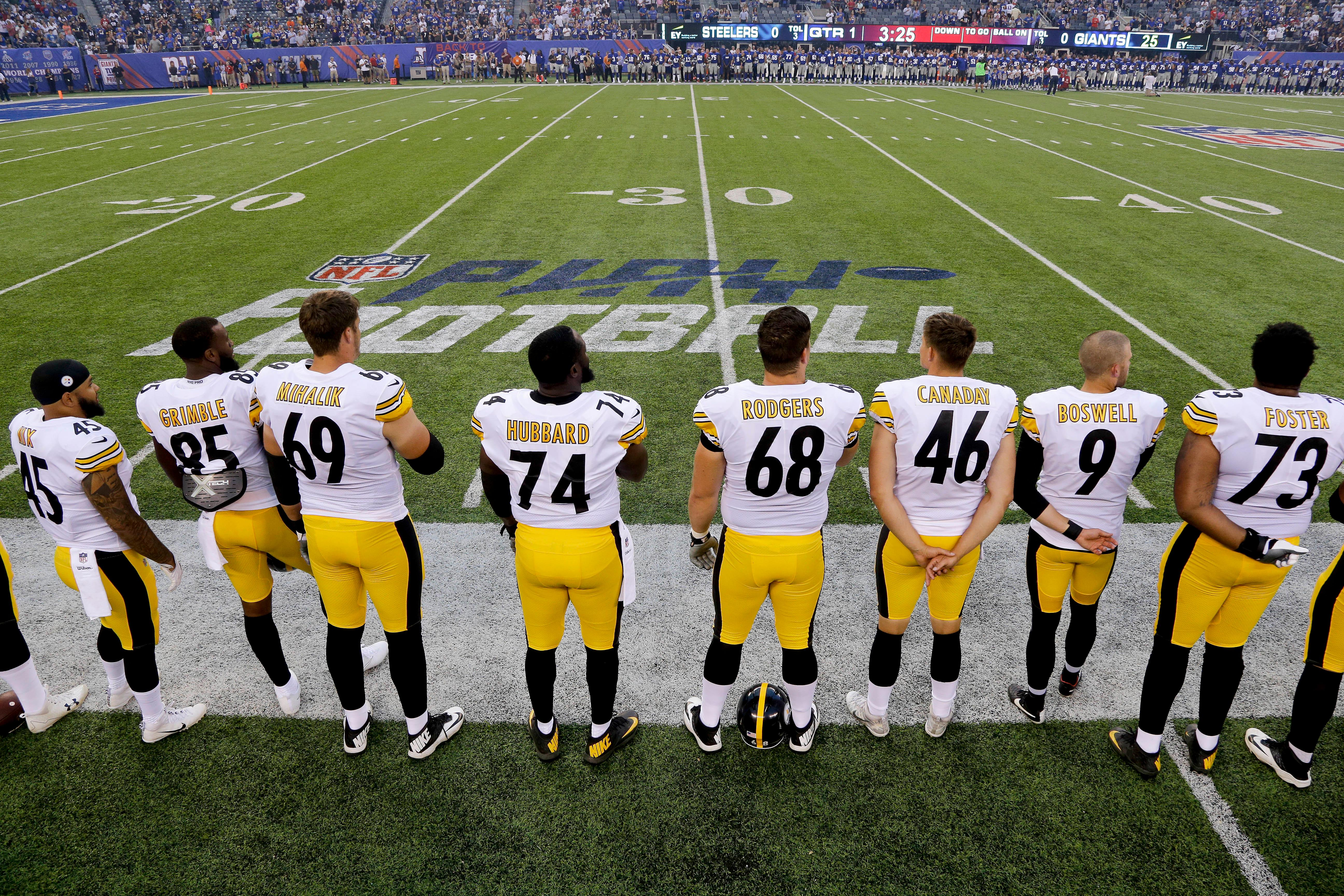 The Pittsburgh Steelers line up for the national anthem before playing against the New York Giants in an NFL football game, Friday, Aug. 11, 2017, in East Rutherford, N.J. (AP Photo/Julio Cortez)