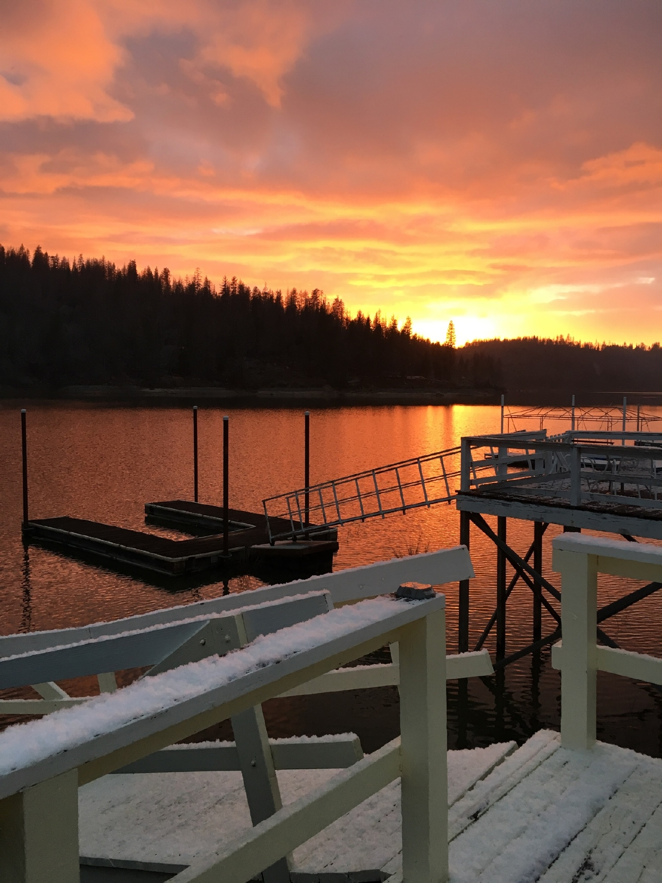 Bass Lake sunset from the snowy dock by Debbie Henes 2/23/17